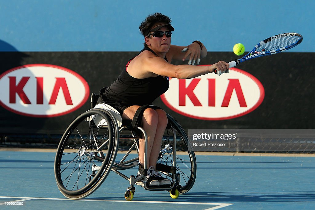Daniela Di Toro of Australia plays a backhand in her Women's Wheelchair Doubles Semifinal match with Kgothatso Montjane Aniek Van Koot of the Netherlands during the 2013 Australian Open Wheelchair Championships at Melbourne Park on January 24, 2013 in Melbourne, Australia.