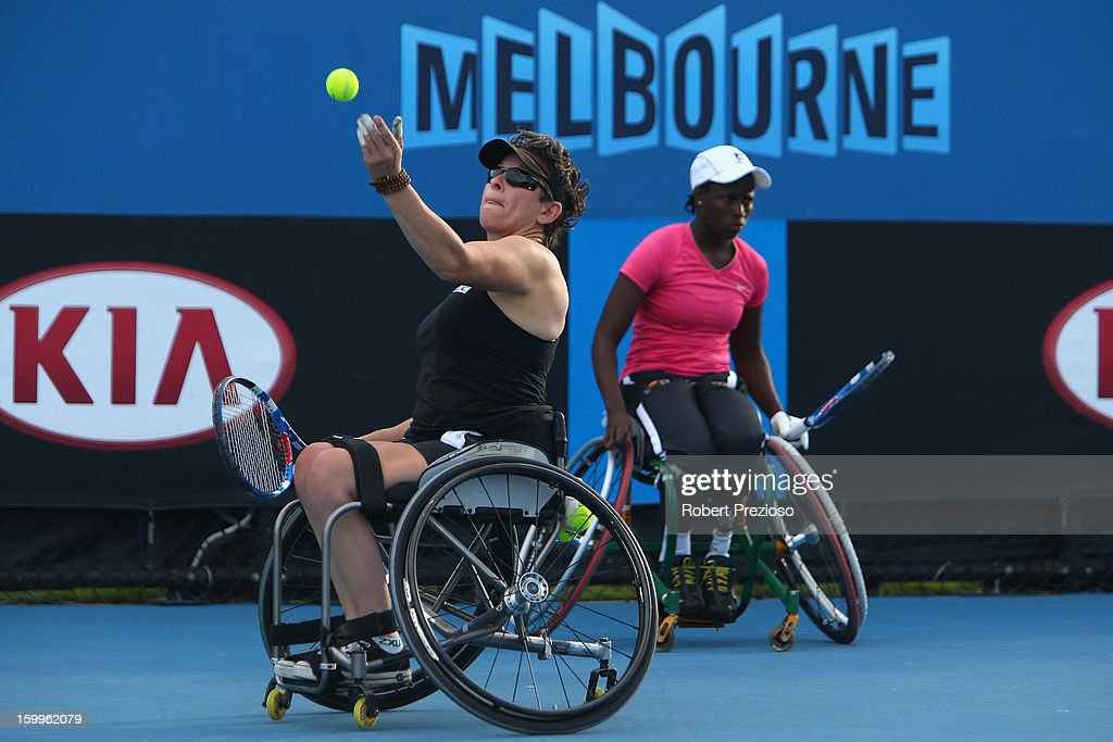 Daniela Di Toro of Australia serves in her Women's Wheelchair Doubles Semifinal match with Kgothatso Montjane Aniek Van Koot of the Netherlands during the 2013 Australian Open Wheelchair Championships at Melbourne Park on January 24, 2013 in Melbourne, Australia.