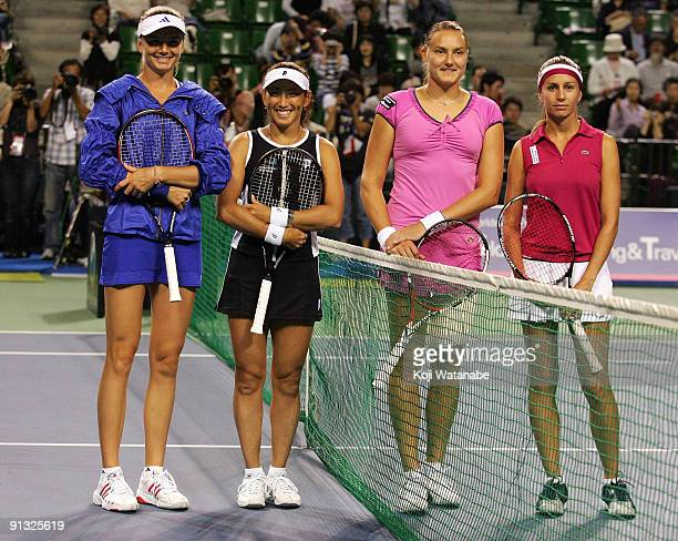 Daniela Hantuchova of Slovakia and Ai Sugiyama of Japan and Nadia Petrova of Russia and Gisela Dulko of Argentina pose before their doubles match...
