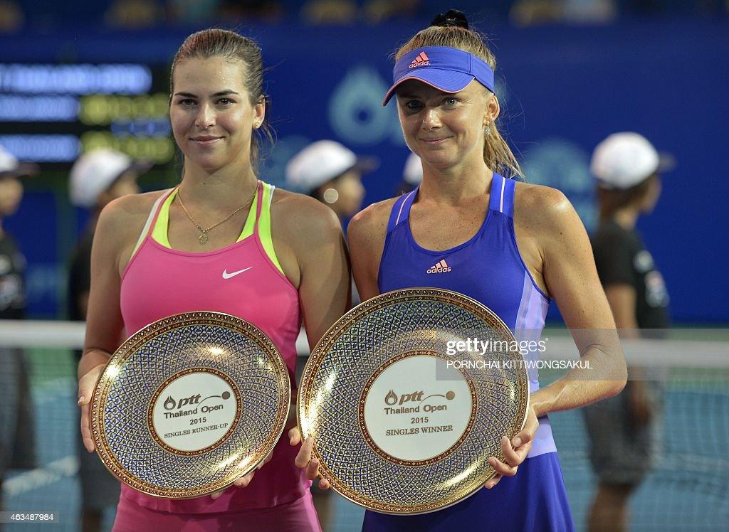 Daniela Hantuchova of Slovakia and Ajla Tomljanovic of Croatia pose with their trophies after Hantuchova won their final round match of the WTA...