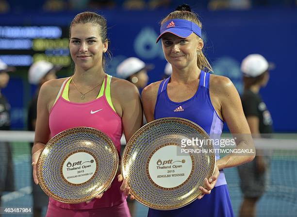 Daniela Hantuchova of Slovakia and Ajla Tomljanovic of Croatia pose with their trophies after Hantuchova won their final round match of the WTA...