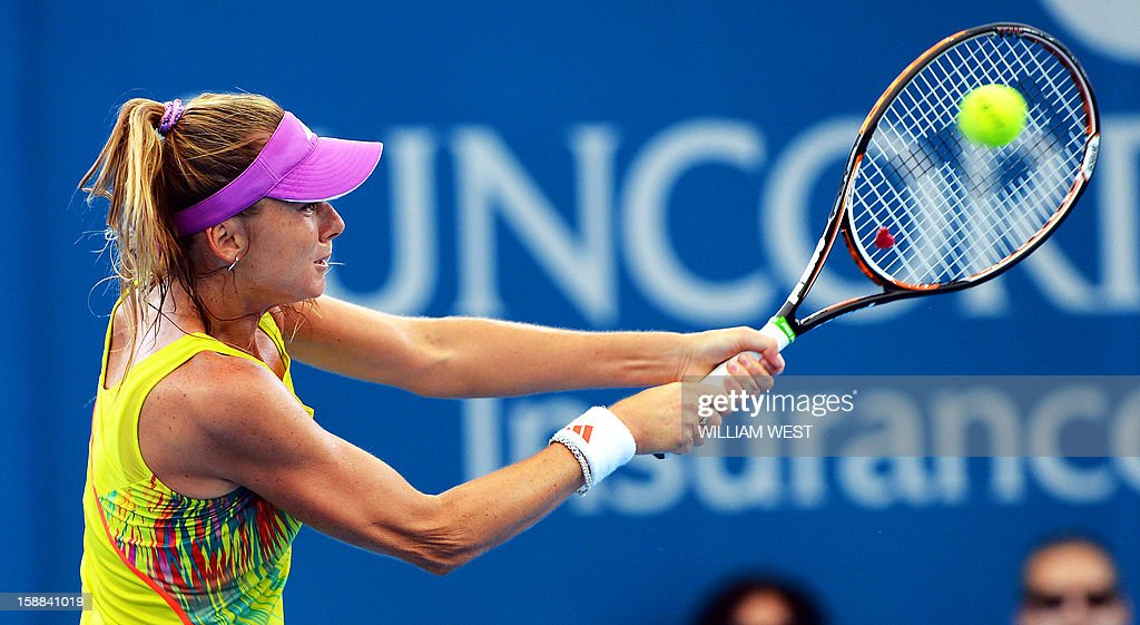 Daniela Hantuchova of Slovakia hits a backhand return during her match against Sara Errani of Italy in the second round of the Brisbane International tennis tournament on January 1, 2013. AFP PHOTO/William WEST USE