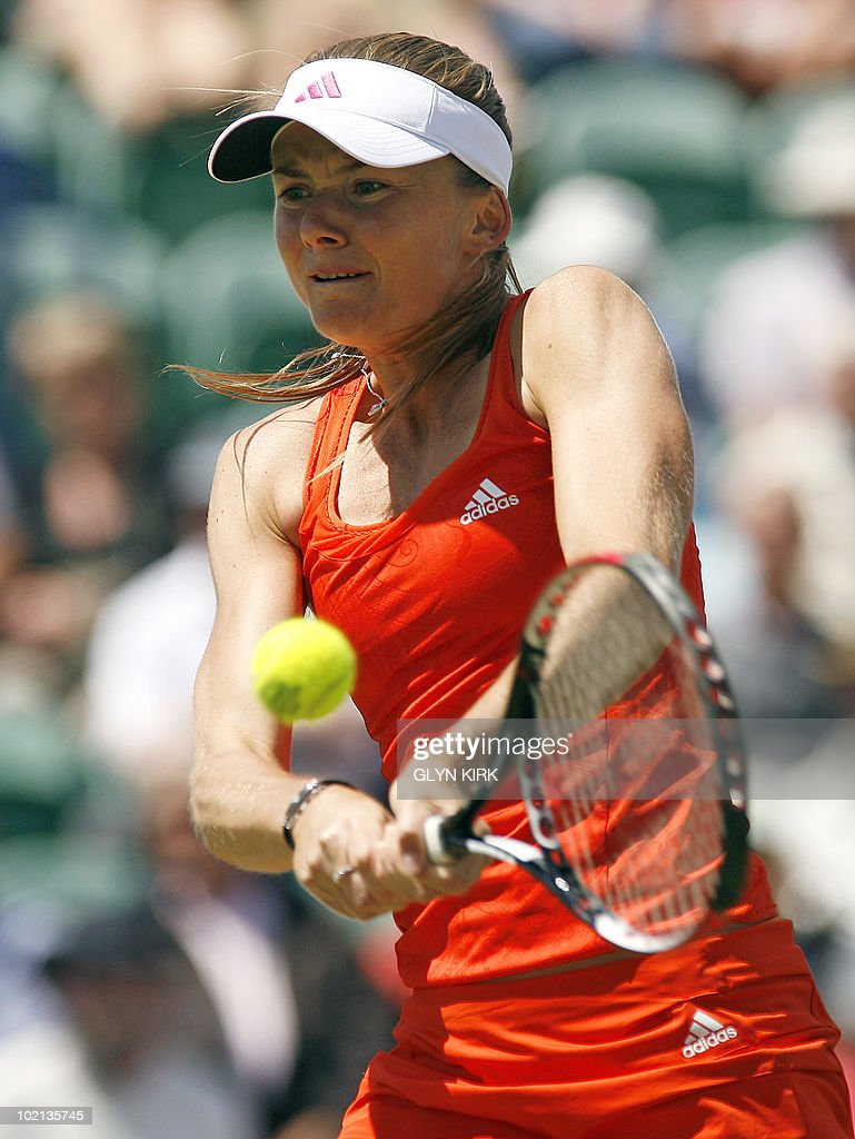 Daniela Hantuchova of Slovakia hits a shot during her second round singles match against Samantha Stosur of Australia on the third day of the AEGON International tennis tournament in Eastbourne, southern England, on June 16, 2010.