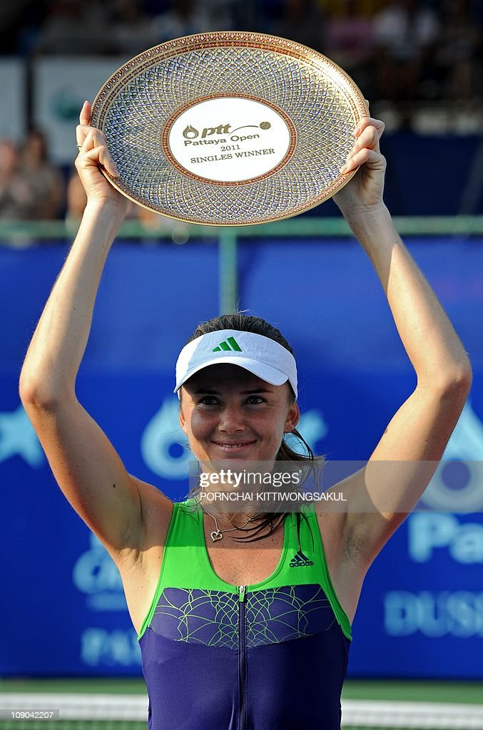 Daniela Hantuchova of Slovakia poses with the trophy after winning against Sara Errani of Italy in final round of tennis PTT Pattaya Open in Pattaya...