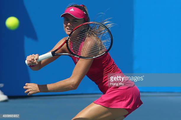 Daniela Hantuchova of Slovakia returns a shot during her match against Barbora Zahlavova Strycova of Czech Republic during day one of the 2014...