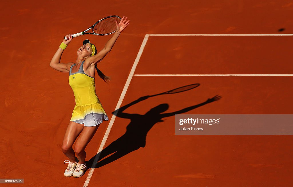 <a gi-track='captionPersonalityLinkClicked' href=/galleries/search?phrase=Daniela+Hantuchova&family=editorial&specificpeople=201969 ng-click='$event.stopPropagation()'>Daniela Hantuchova</a> of Slovakia serves in her match against Sloane Stephens of USA during the Mutua Madrid Open tennis tournament at the Caja Magica on May 4, 2013 in Madrid, Spain.