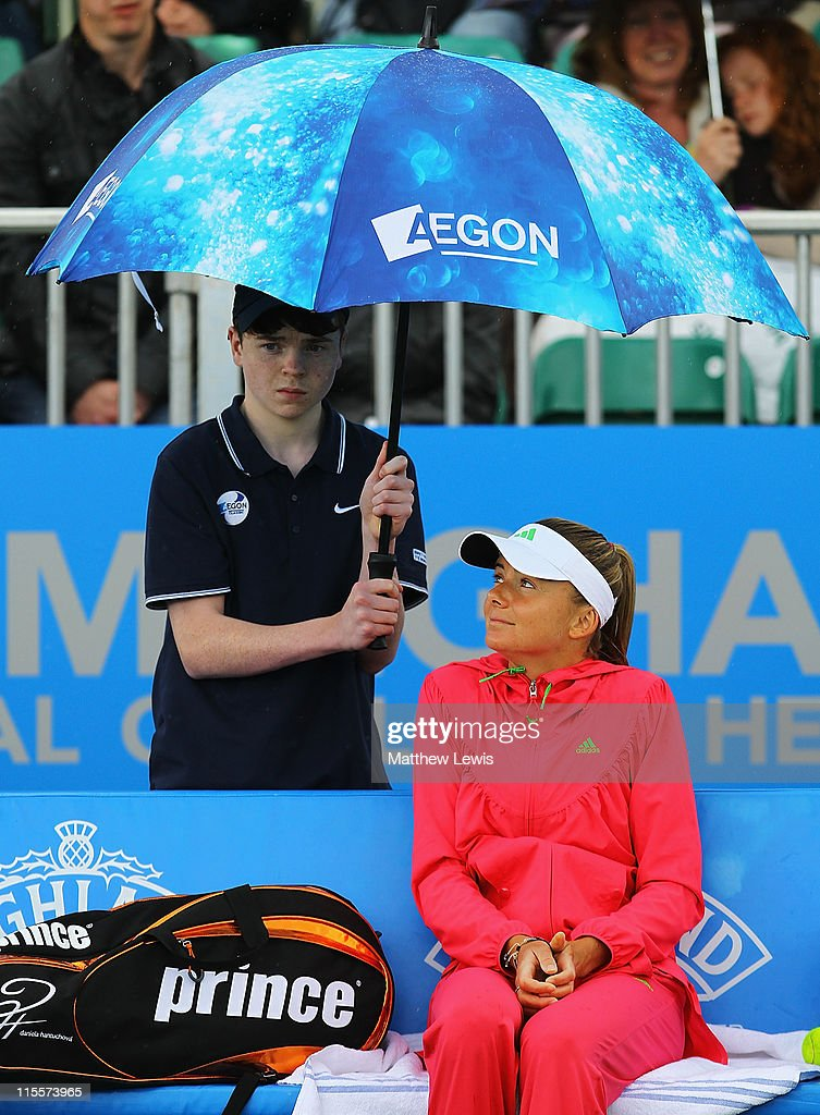 <a gi-track='captionPersonalityLinkClicked' href=/galleries/search?phrase=Daniela+Hantuchova&family=editorial&specificpeople=201969 ng-click='$event.stopPropagation()'>Daniela Hantuchova</a> of Slovakia shelters from the rain during her match against Sorana Cirstea of Romania, as rain interupts play during the third day of the AEGON Classic at the Edgbaston Prior Club on June 8, 2011 in Birmingham, England.