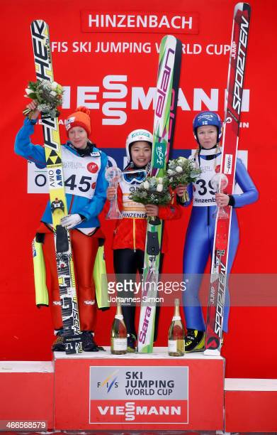 Daniela IraschkoStolz of Austria Sara Takanashi of Japan and Julia Kykkaenen of Finland participate in the award ceremony of the Normal Hill...