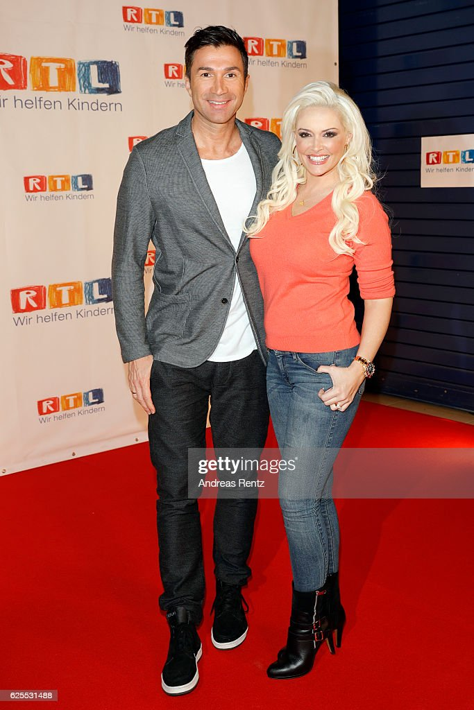 Daniela Katzenberger (R) and her husband Lucas Cordalis arrive for the RTL Telethon (RTL Spendenmarathon) TV show on November 24, 2016 in Cologne, Germany. The telethon is held every year and is on air for 24 hours.