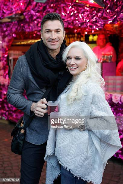 Daniela Katzenberger and her husband Lucas Cordalis pose during the 'Daniela Katzenberger mit Lucas im Weihnachtsfieber' photocall at Christmas...