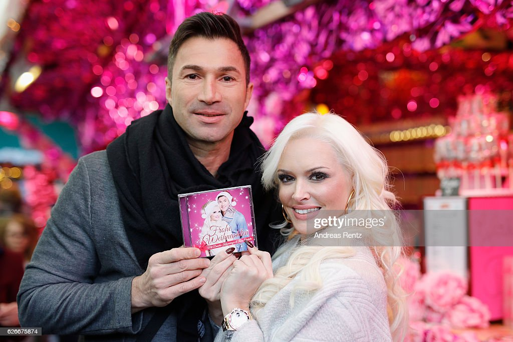 Daniela Katzenberger and her husband Lucas Cordalis pose during the 'Daniela Katzenberger - mit Lucas im Weihnachtsfieber' photocall at Christmas Avenue on November 30, 2016 in Cologne, Germany.