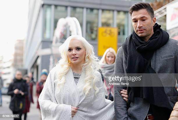 Daniela Katzenberger and her husband Lucas Cordalis walk together after the 'Daniela Katzenberger mit Lucas im Weihnachtsfieber' photocall at...