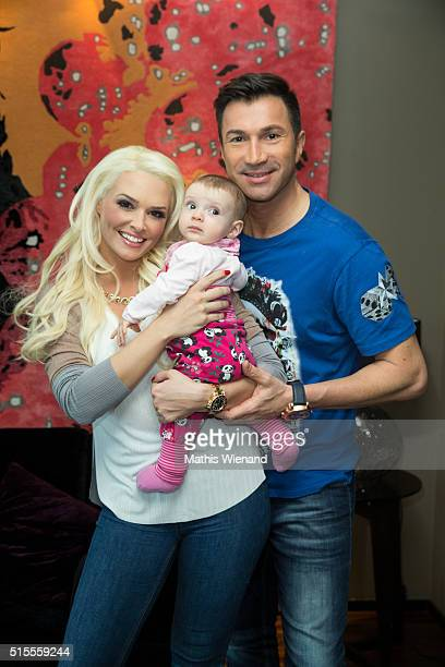 Daniela Katzenberger her fiance Lucas Cordalis and their baby Sophia pose during a photo call in a Suite at Savoy Hotel Cologne on March 14 2016 in...