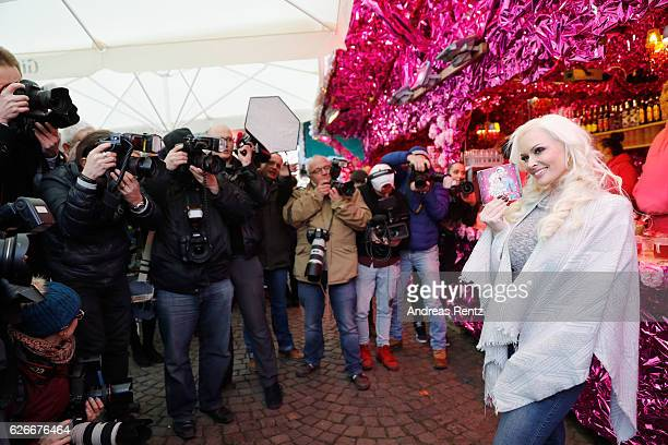 Daniela Katzenberger poses for photographers during the 'Daniela Katzenberger mit Lucas im Weihnachtsfieber' photocall at Christmas Avenue on...