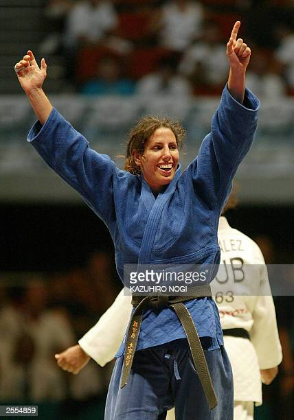 Daniela Krukower of Argentina celebrates her victory over Driulis Gonzalez of Cuba during the women's 63 kg category final match at the World Judo...