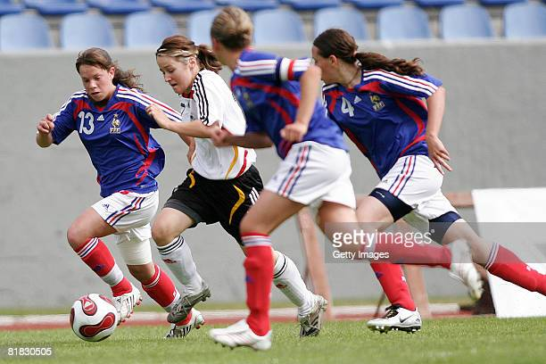 Daniela Lieem fights for the ball with Marion Torrent Jessica Margaretta and Clo Fallant of France during the U16 Nordic Cup match between Germany...