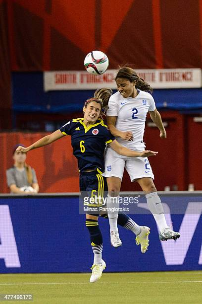 Daniela Montoya of Colombia and Alex Scott of England jump for the ball during the 2015 FIFA Women's World Cup Group F match at Olympic Stadium on...