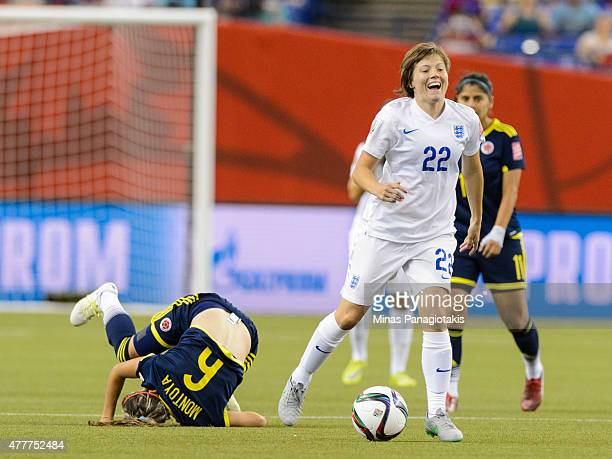 Daniela Montoya of Colombia falls behind Fran Kirby of England during the 2015 FIFA Women's World Cup Group F match at Olympic Stadium on June 17...