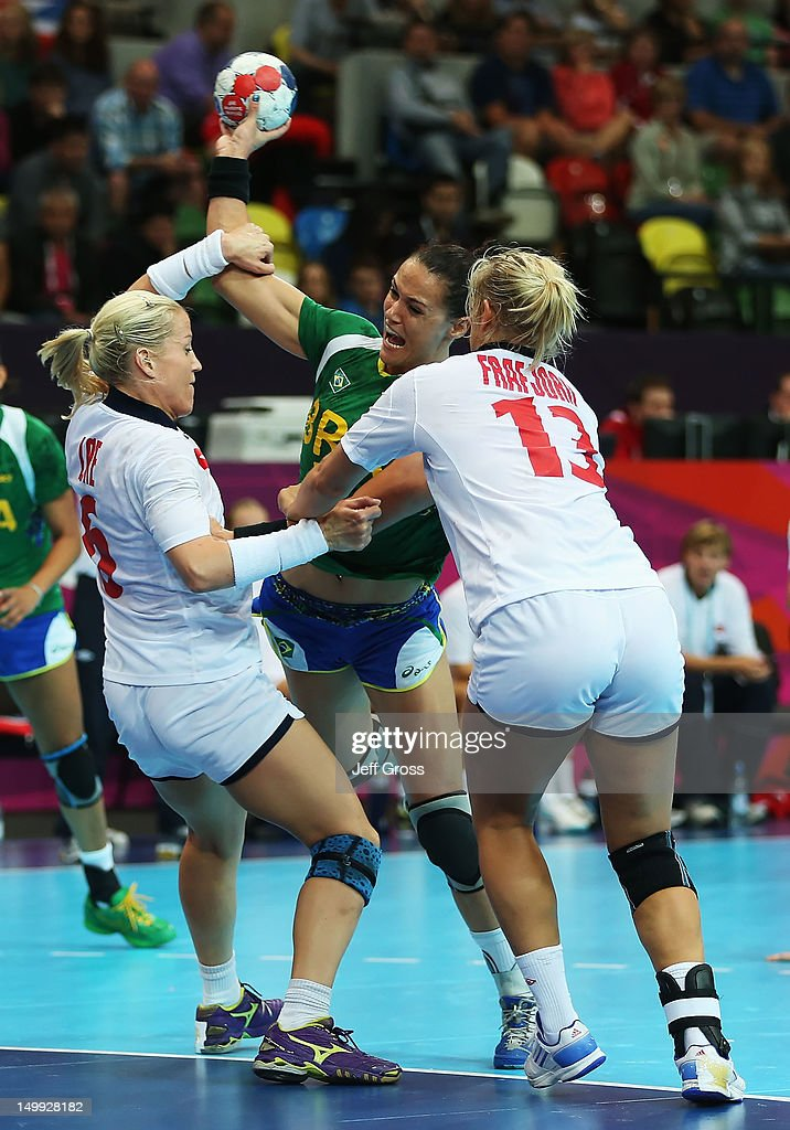 Daniela Piedade (center) #5 of Brazil is defended by <a gi-track='captionPersonalityLinkClicked' href=/galleries/search?phrase=Heidi+Loke&family=editorial&specificpeople=6331820 ng-click='$event.stopPropagation()'>Heidi Loke</a> (L) #6 and Marit Malm Frafjord (R) #13 of Norway during the Women's Quarterfinal match between Brazil and Norway on Day 11 of the London 2012 Olympic Games at The Copper Box on August 7, 2012 in London, England.
