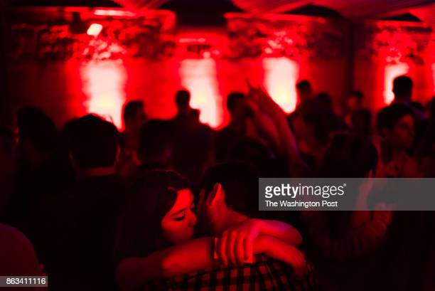 Daniela Pinto of DC left kisses Aymen Mohammed of DC After the restaurant closes El Centro DF on 14th street turns in to a late night Latin dance...