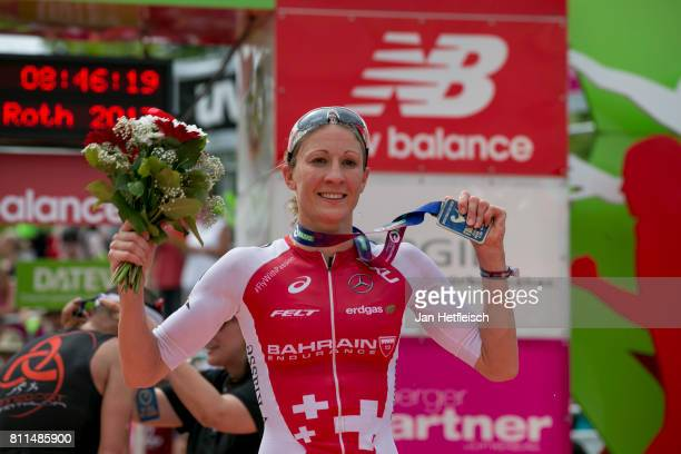 Daniela Ryf of Switzerland celebrate the winning of the first place at the DATEV Challenge Roth 2017 on July 9 2017 in Roth Germany 5000 athletes are...