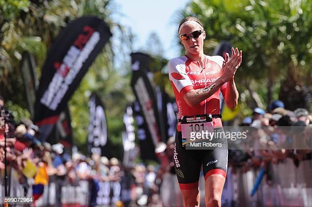 Daniela Ryf of Switzerland celebrates at the finish line during Ironman 703 World Championship on September 4 2016 in Sunshine Coast Australia