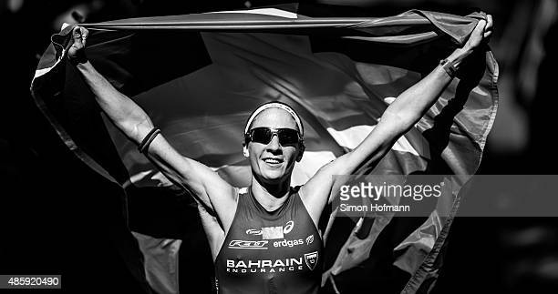 Daniela Ryf of Switzerland celebrates winning after competing in the Ironman 703 World Championship Zell am See Kaprun on August 30 2015 in Zell am...