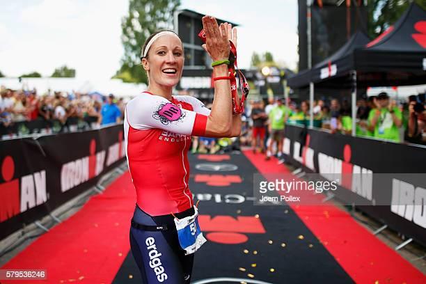 Daniela Ryf of Switzerland celebrates winning the womens race during Ironman Zurich on July 24 2016 in Zurich Switzerland