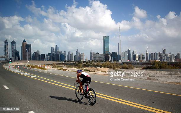 Daniela Ryf of Switzerland competes in the cycle leg of the womens race as she cycles back toward the Dubai city skyline during the Challenge...