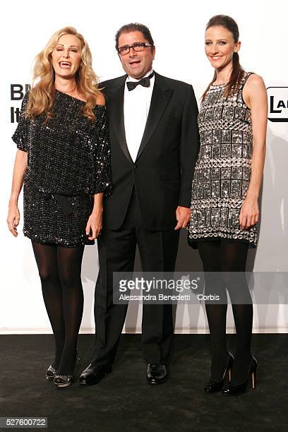Daniela Santanche with family on the AmfAR Milano 2009 red carpet during the inaugural Milan Fashion Week event at La Permanente