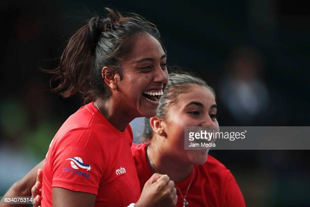 Daniela Seguel and Barbara Gatica of Chile celebrate during the first day of the Tennis Fed Cup American Zone Group 1 at Club Deportivo La Asuncion...