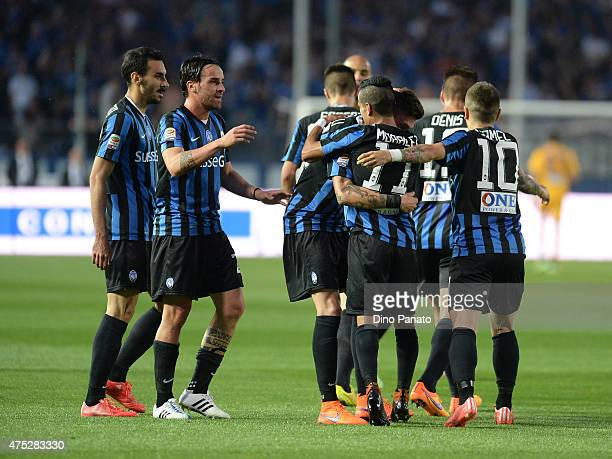 Daniele Baselli of Atalanta BC is mobbed by team mates after scoring his his opening goal during the Serie A match between Atalanta BC and AC Milan...
