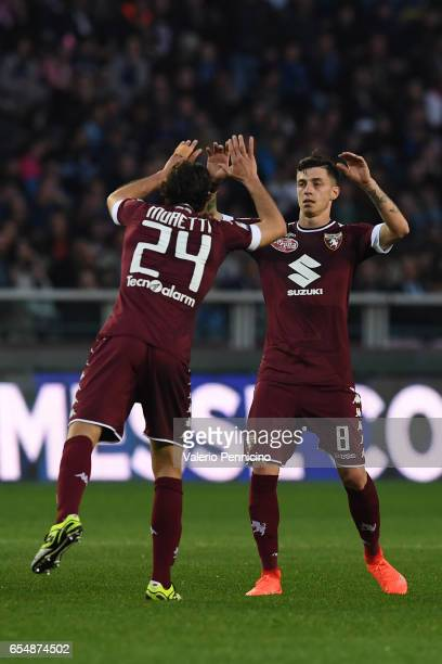 Daniele Baselli of FC Torino celebrates a goal with team matye Emiliano Moretti during the Serie A match between FC Torino and FC Internazionale at...