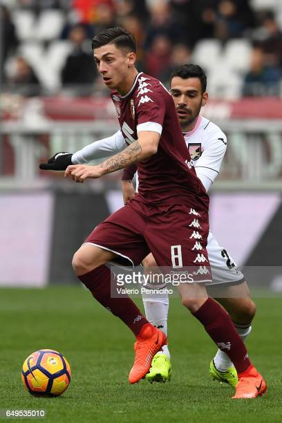 Daniele Baselli of FC Torino in action against Bruno Henrique Corsini of US Citta di Palermo during the Serie A match between FC Torino and US Citta...
