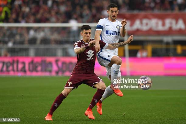 Daniele Baselli of FC Torino is challenged by Roberto Gagliardini of FC Internazionale during the Serie A match between FC Torino and FC...