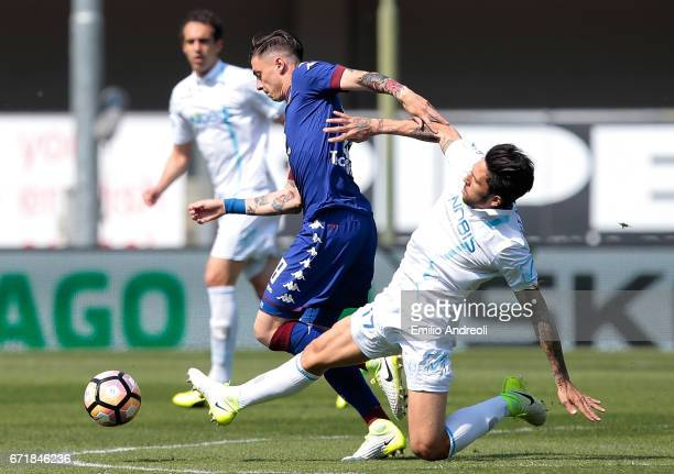 Daniele Baselli of Torino FC competes for the ball with Lucas Nahuel Castro of AC ChievoVerona during the Serie A match between AC ChievoVerona and...