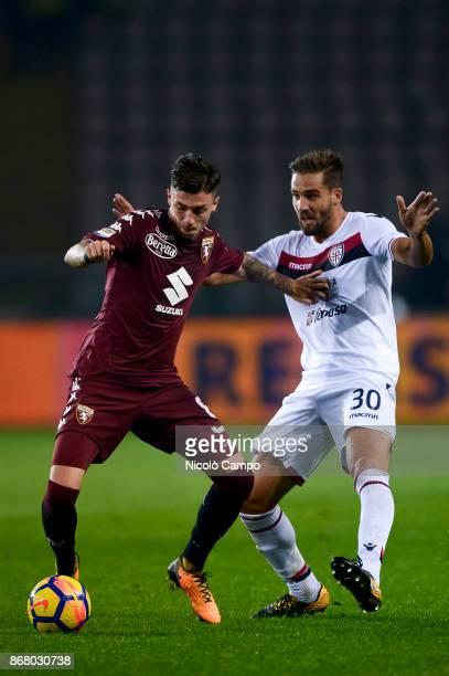 Daniele Baselli of Torino FC competes with Leonardo Pavoletti of Cagliari Calcio during the Serie A football match between Torino FC and Cagliari...
