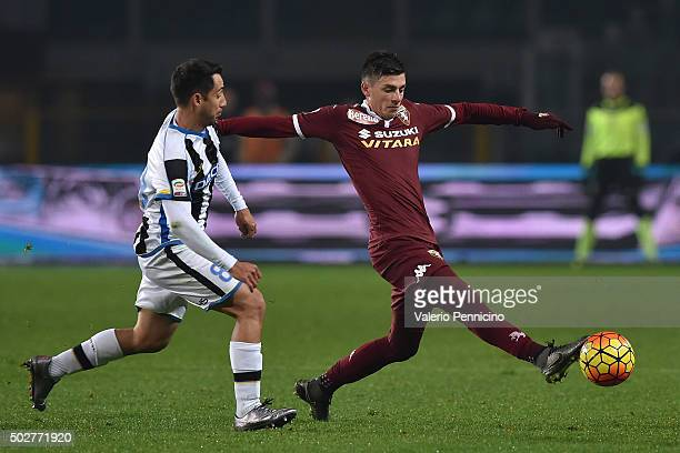 Daniele Baselli of Torino FC in action against Bruno Fernandes of Udinese Calcio during the Serie A match between Torino FC and Udinese Calcio at...