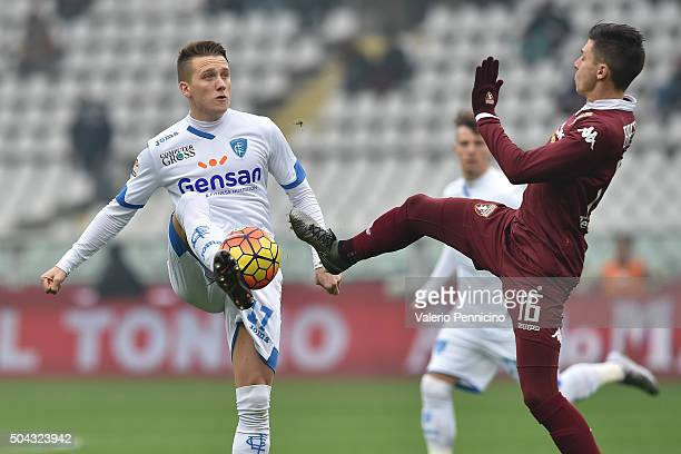 Daniele Baselli of Torino FC tackles Piotr Zielinski of Empoli FC during the Serie A match between Torino FC and Empoli FC at Stadio Olimpico di...