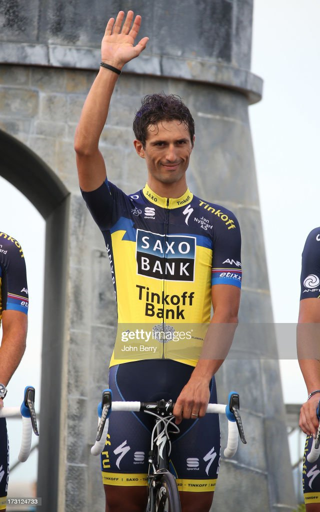 <a gi-track='captionPersonalityLinkClicked' href=/galleries/search?phrase=Daniele+Bennati&family=editorial&specificpeople=584838 ng-click='$event.stopPropagation()'>Daniele Bennati</a> of Italy and Team Saxo-Tinkoff at the Team Presentation prior to the start of the Tour de France 2013 on June 27, 2013 in Porto-Vecchio, Corsica, France.
