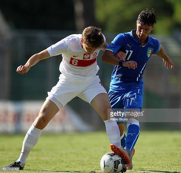 Daniele Bezziccheri of Italy competes for the ball with Krystian Bielik of Poland during the international match between Italy U18 and Poland U18 on...