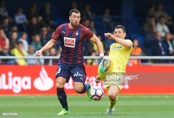 Daniele Bonera of Villarreal CF and Sergi Enrich of SD Eibar during their La Liga match between Villarreal CF and SD Eibar at the Estadio de La...