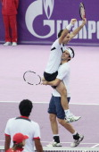 Daniele Bracciali and Potito Starace of Italy celebrate their win during final match of the International Tennis Tournamen St Petersburg Open 2010...