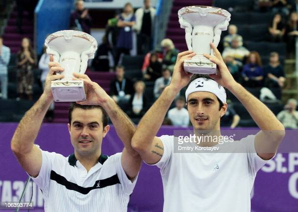 Daniele Bracciali and Potito Starace of Italy with cups after their win during final match of the International Tennis Tournamen St Petersburg Open...