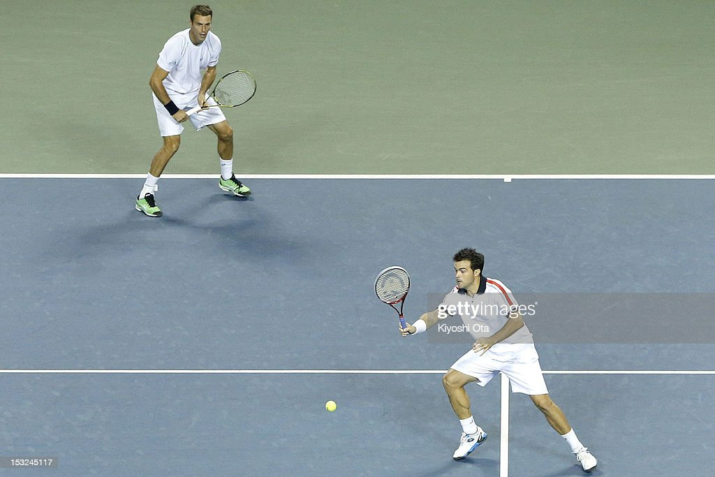 Daniele Bracciali (R) of Italy and Frantisek Cermak of the Czech Republic play in their first round doubles match against Yuichi Sugita and Yasutaka Uchiyama of Japan during day two of the Rakuten Open at Ariake Colosseum on October 2, 2012 in Tokyo, Japan.