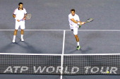 Daniele Bracciali of Italy and Frantisek Cermak of the Czech Republic in action during their semi final doubles match against Radek Stepanek of the...