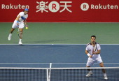 Daniele Bracciali of Italy and Santiago Gonzalez of Mexico play in their first round doubles match against David Ferrer and Marc Lopez of Spain...