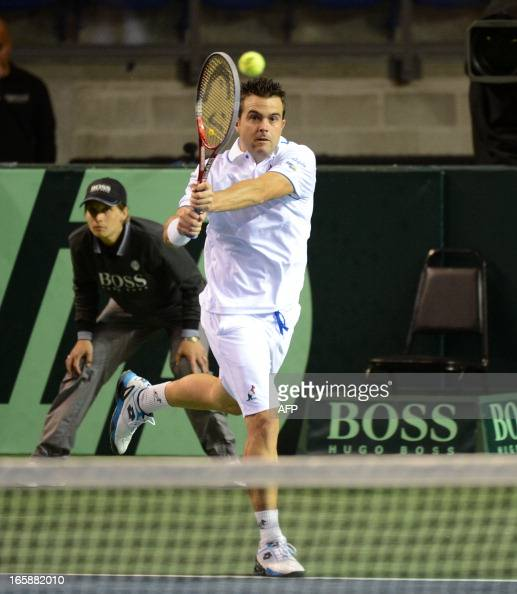 Daniele Bracciali of Italy hits a return during the doubles rubber against Daniel Nestor and Vasek Pospisil of Canada at the Davis Cup World Group on...