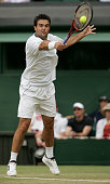 Daniele Bracciali of Italy in action against Andy Roddick of USA during the fifth day of the Wimbledon Lawn Tennis Championship on June 24 2005 at...