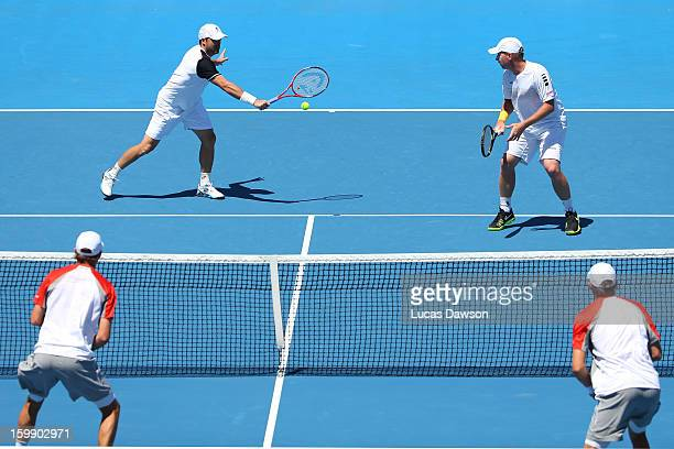 Daniele Bracciali of Italy plays a backhand in his fourth round doubles match with Lukas Dloughy of the Czech Republic against Mike Bryan of the...